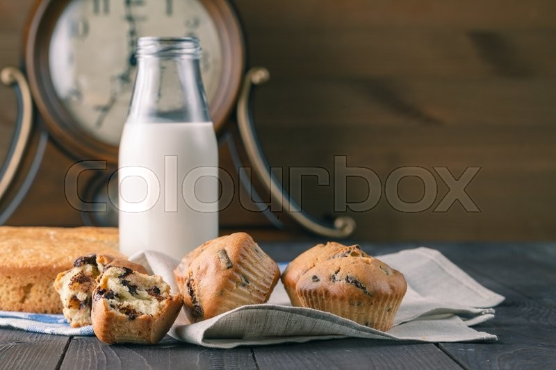 Stock image of 'Breakfast for children witj muffins and milk on table'