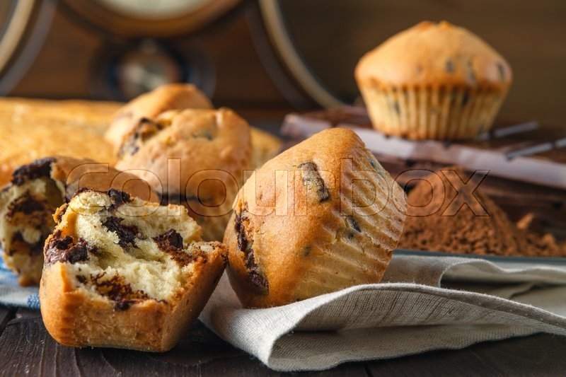 Stock image of 'Holiday breakfast with pastry. Muffins and manna pie on wooden table'