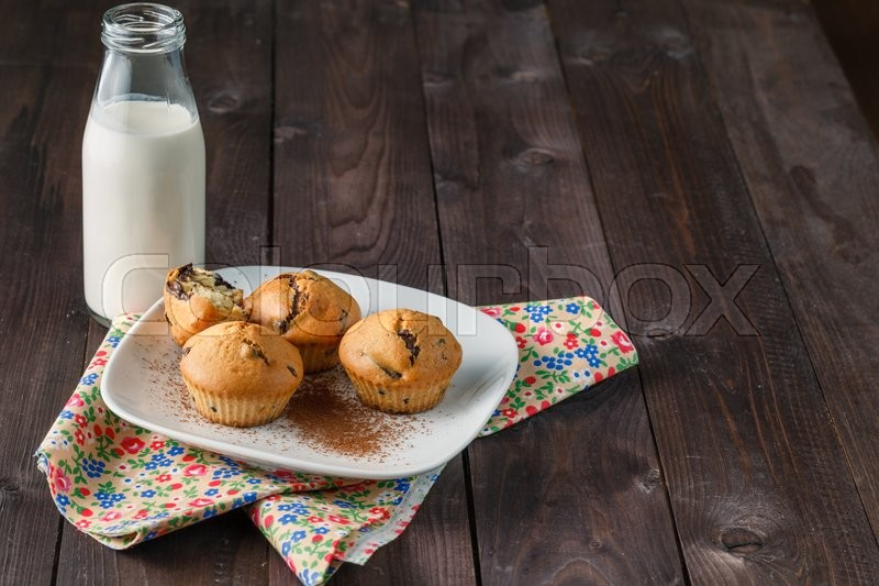 Stock image of 'Breakfast with pastry and milk in bottle on table'