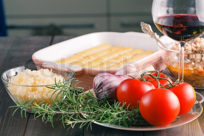 Stock image of 'Cooking cannelloni on kitchen. Italian traditional food'