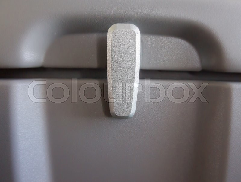 Stock image of 'Locker of storage behind the passenger seat in the plane'