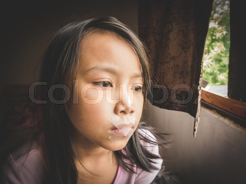 Stock image of 'Concept Idea, Little kid was gagged with plastic tape. Vintage Filter Effect'