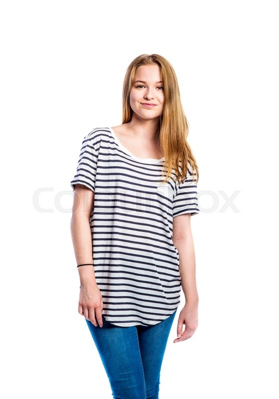 Stock image of 'Teenage girl in jeans and striped t-shirt, young woman, studio shot on white background'