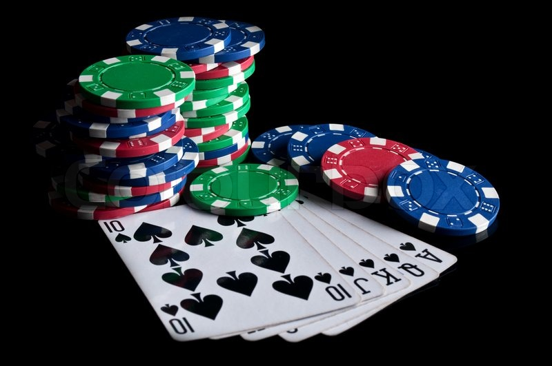 Royal flush and poker chips on a black background | Stock ...