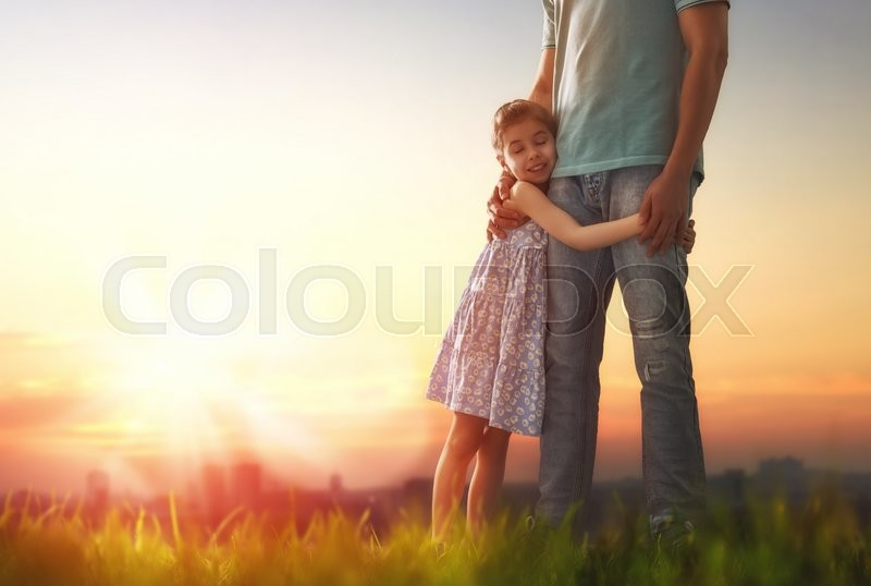 Happy loving family. Father and his daughter child girl playing and hugging outdoors. Cute little girl hugs daddy. Concept of Father\'s day, stock photo