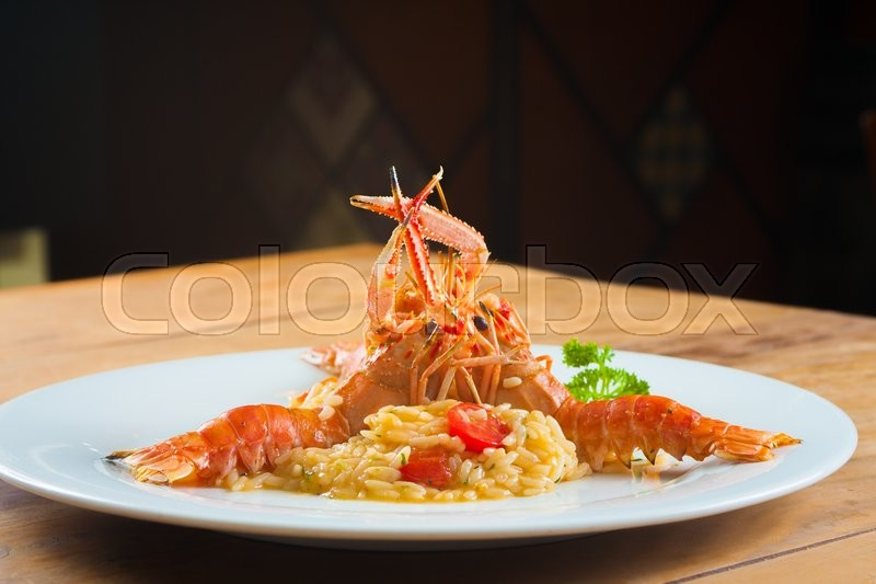 Fresh Gourmet Lagostines with sea food risotto, stock photo