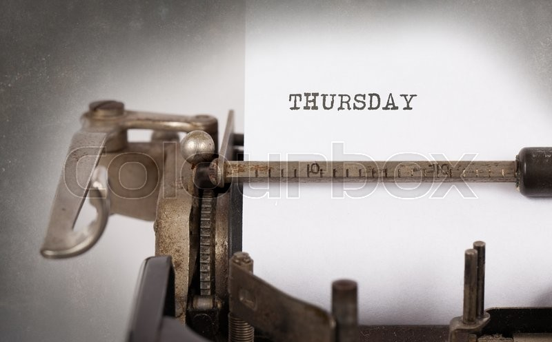 Stock image of 'Thursday typography on a vintage typewriter, close-up'