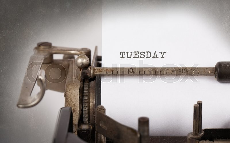 Stock image of 'Wednesday typography on a vintage typewriter, close-up'