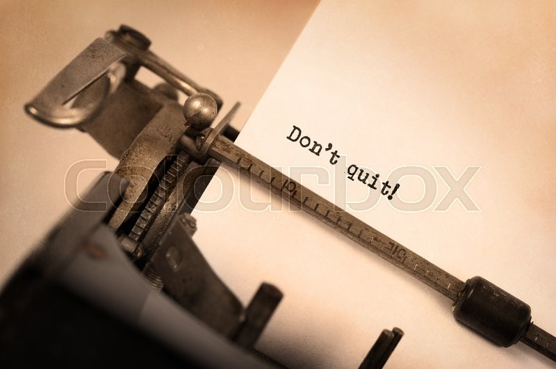 Stock image of 'Vintage typewriter close-up - Don't Quit determination message'