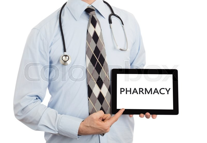Stock image of 'Doctor, isolated on white backgroun,  holding digital tablet - Pharmacy'