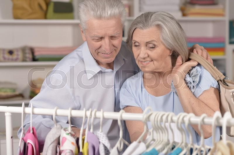 Stock image of 'Portrait of a happy senior couple  shopping'