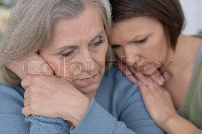 Stock image of 'miserable senior mother and adult daughter together'