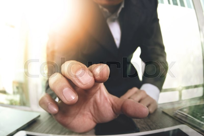 Stock image of 'Close up of businessman hand working with touch screen computer as concept'