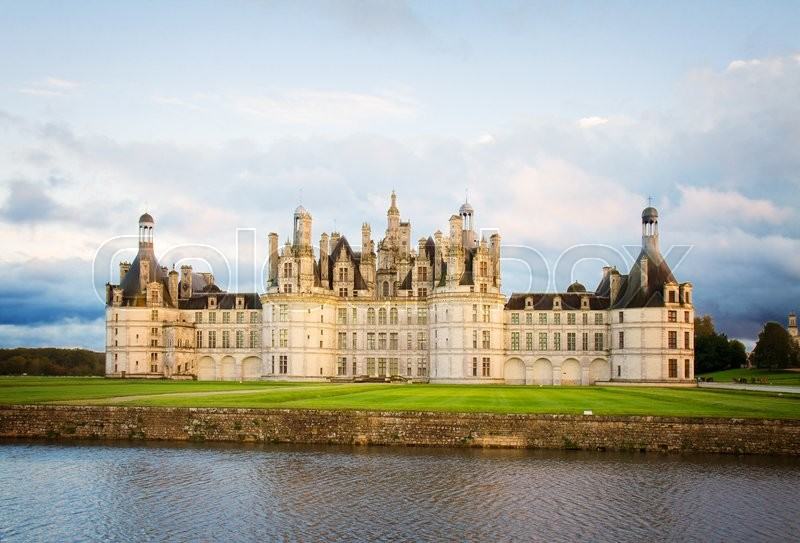 Stock image of 'facade of Chambord chateau at sunset, Pays-de-la-Loire, France, retro toned'