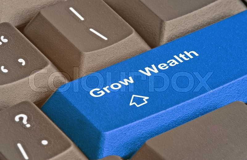 Stock image of 'Keyboard with key to grow  wealth'