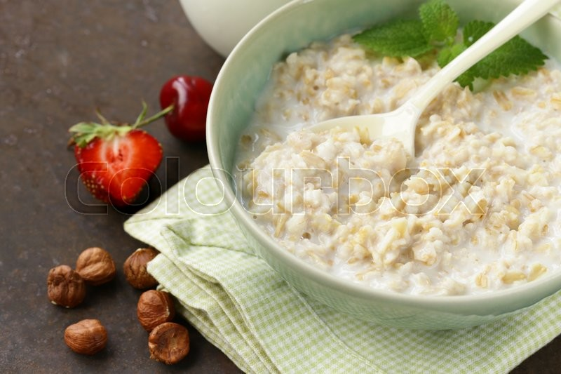 Stock image of 'Oatmeal porridge with milk - healthy breakfast'