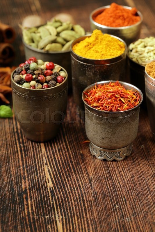 Stock image of 'Variety of spices (saffron, paprika, pepper, fennel, cinnamon, turmeric, nutmeg)'