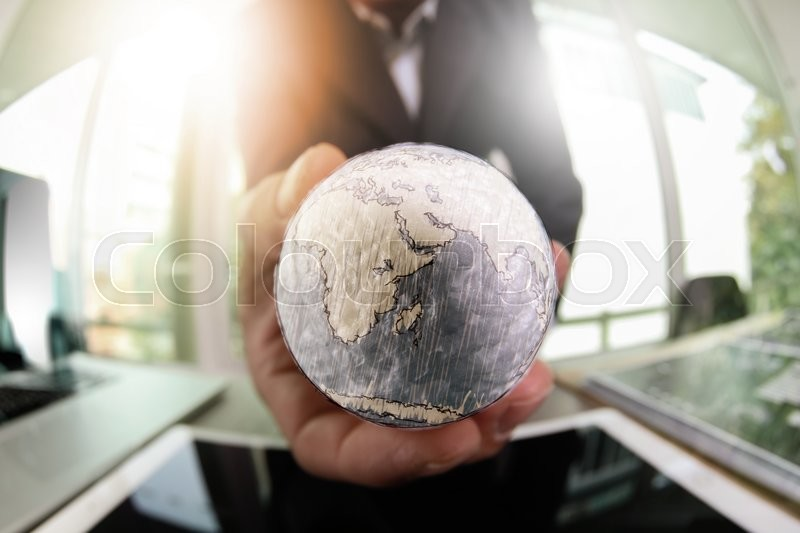 Stock image of 'close up of businessman hand showing texture the world with digital social media network diagram concept Elements of this image furnished by NASA\\ '