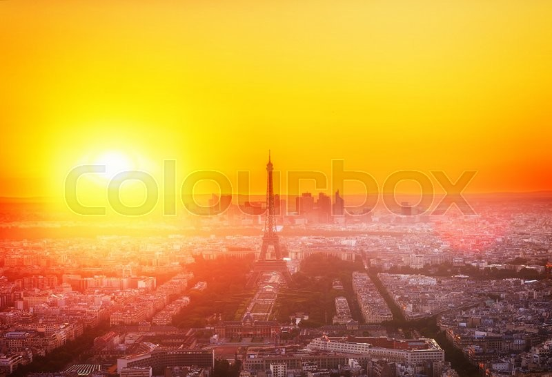Stock image of 'skyline of Paris with Eiffel Tower  from above in orange sunset sunlight, France, toned'