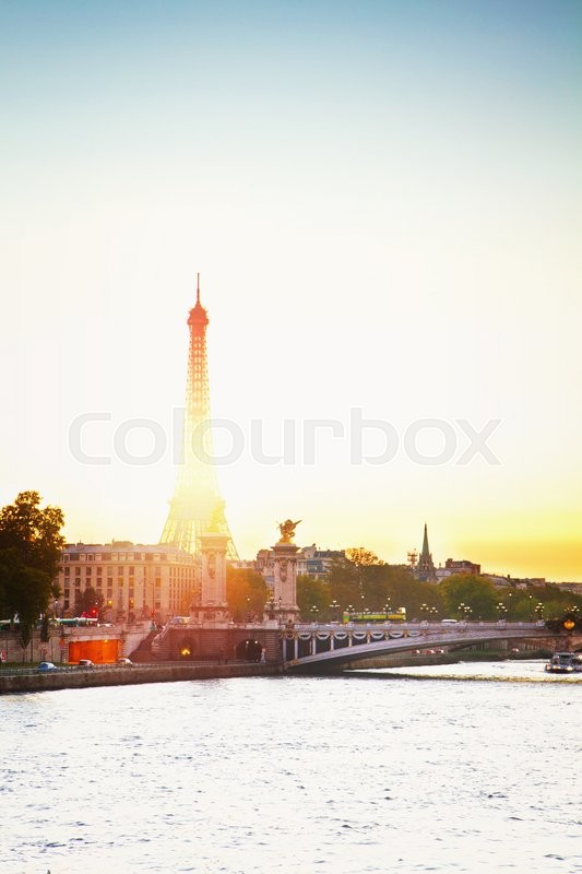 Stock image of 'Eiffel tower over Alexandre III Bridgeat at sunset,  Paris, France, retro toned'