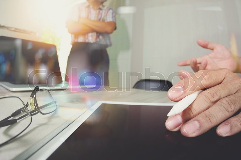 Stock image of 'Businessman making presentation with his colleagues and business tablet digital computer at the office as concept\\ '