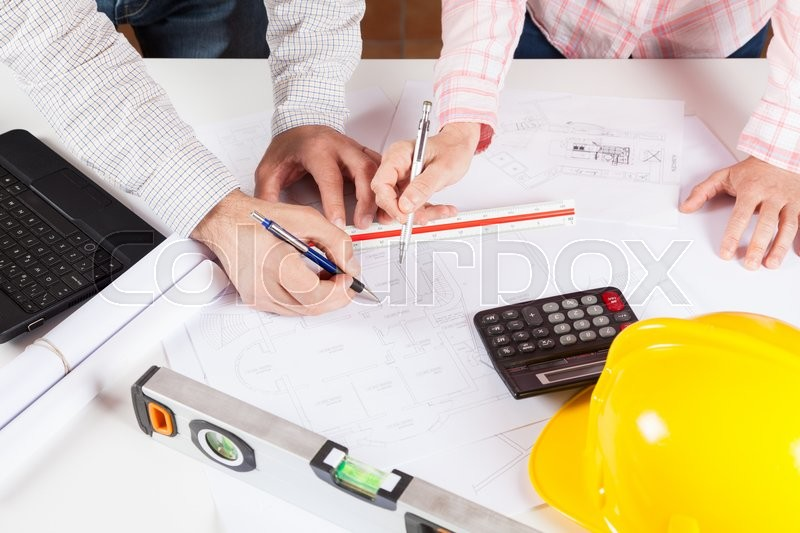 Stock image of 'Architects meeting discussing a new draft plans'