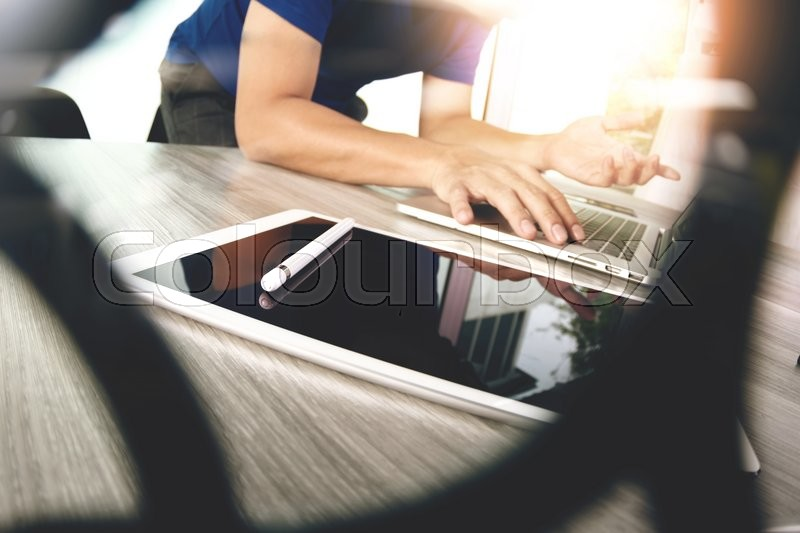 Stock image of 'Website designer working blank screen digital tablet and computer laptop with smart phone on wooden desk as concept  '