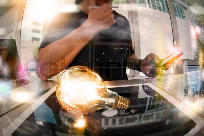 Stock image of 'designer hand showing creative business strategy with light bulb and digital design diagram as concept'