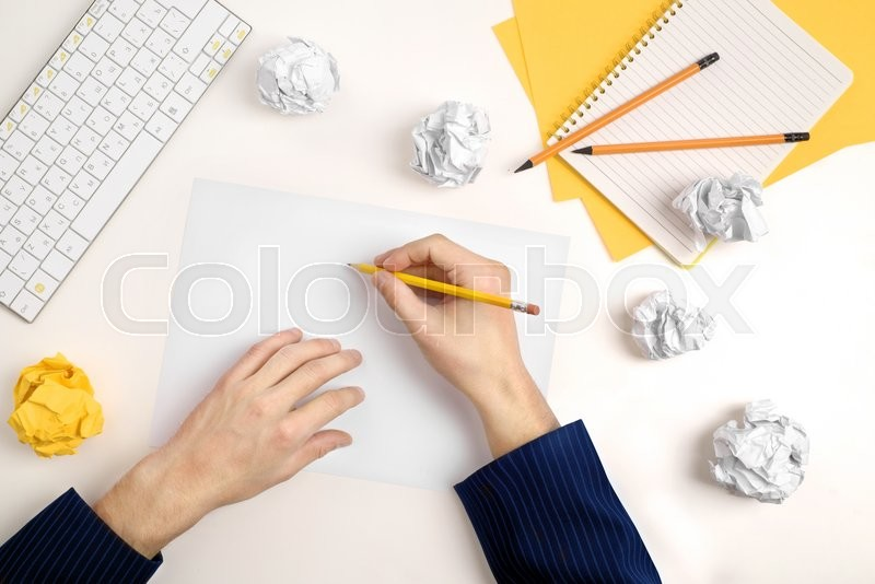 Stock image of 'hands of a man thinking about idea with sheet of paper and pencil '
