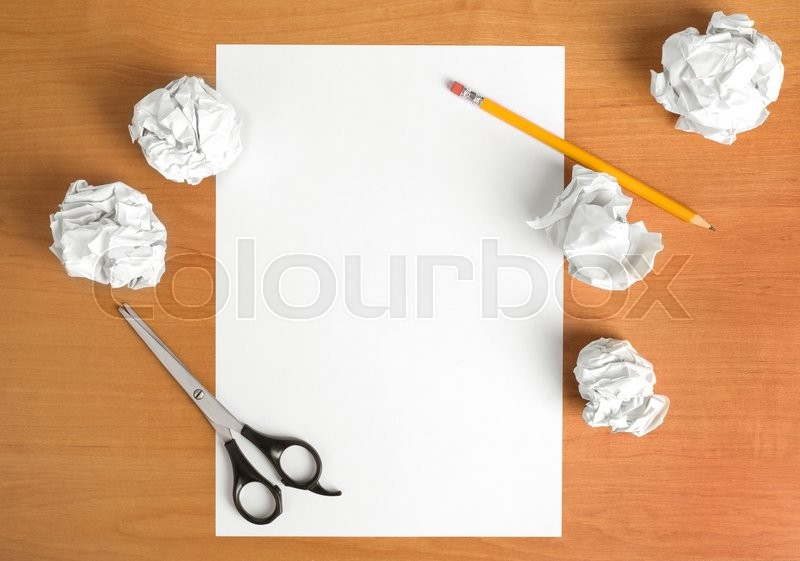 Stock image of 'wooden table with scissors,sheet of paper and pencil '