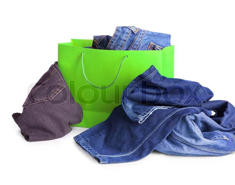 Stock image of 'Jeans in the shopping bag on white '