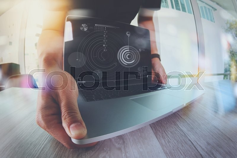 Stock image of 'Designer hand working with laptop computer on wooden desk as responsive web design concept\\ '