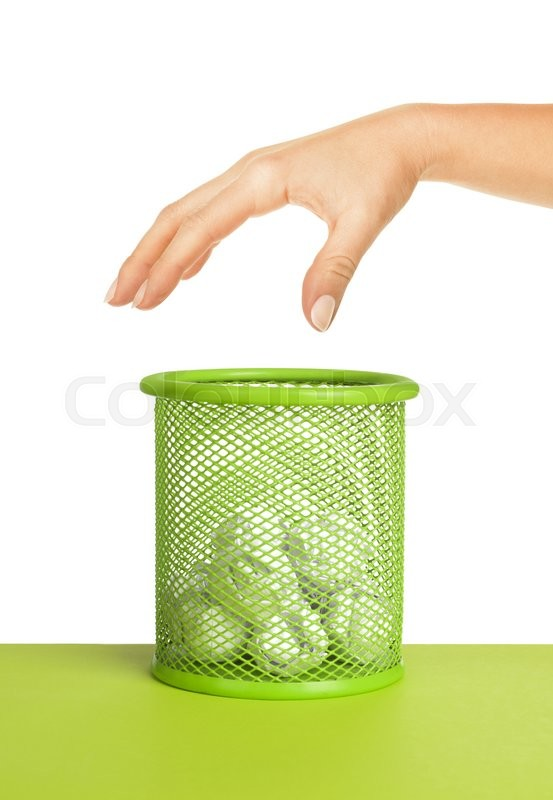Stock image of 'Hand near wastebasket full of waste paper and fly ball'