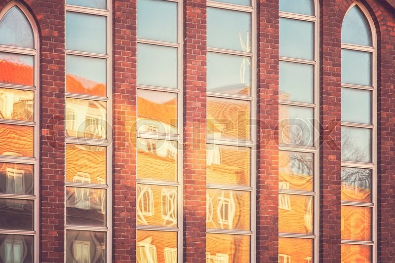 Stock image of 'Image of windows reflecting buildings.'