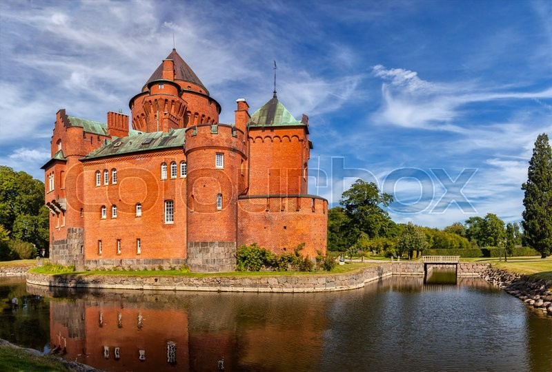 Stock image of 'Image of Hjularod red brick castle in Sweden, built in a french medieval romantic style. '