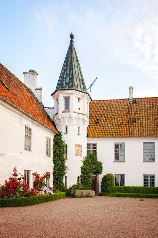 Stock image of 'Image of the courtyard tower by Bosjokloster historic monastery, Sweden. '