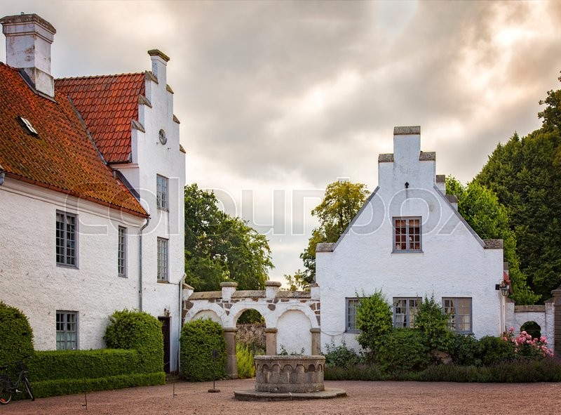 Stock image of 'Image of the rustic courtyard of Bosjokloster, Sweden. This historic monastery is a popular tourist destination. '