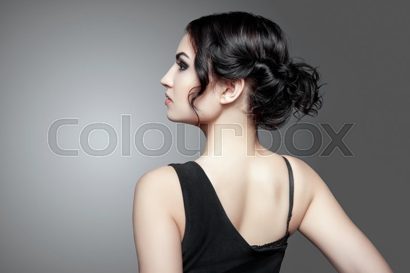 Stock image of 'Fashion Brunette Girl. Profile portrait of a beautiful  woman on dark background. Luxury woman. Concept of beauty and fashion.'