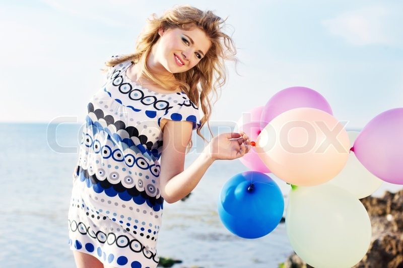 Happy girl with colorful ballo...