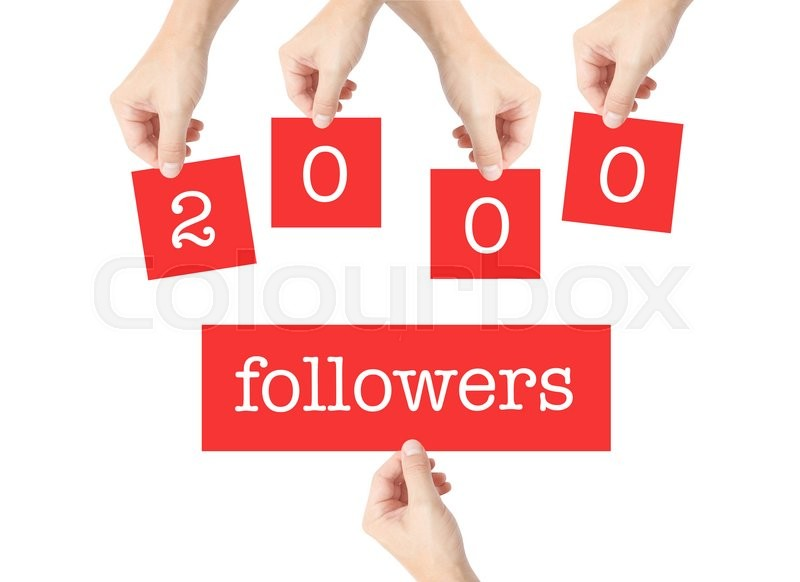 Stock image of '2000 followers written on cards held by hands'