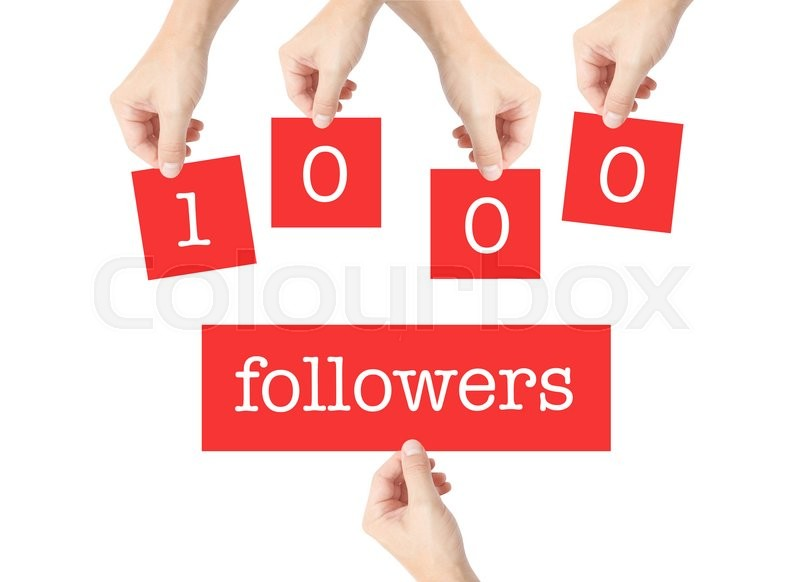 Stock image of '1000 followers written on cards held by hands'