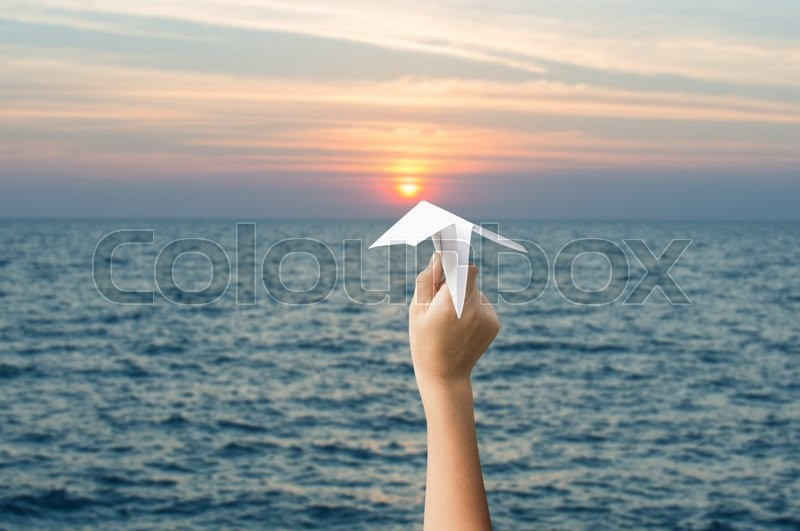 Stock image of 'Plane paper in children hands and sunset, forward to the target concept.'