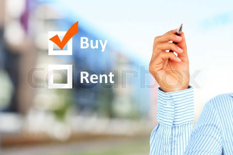 Stock image of 'Buy or rent concept. Building on the background'