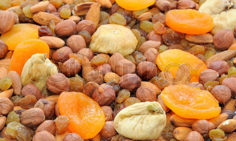 Stock image of 'Various dried fruits (apricots, dates, raisins, figs) close-up '