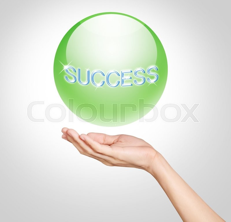 Stock image of 'Hands holding up a green translucent ball with success text'