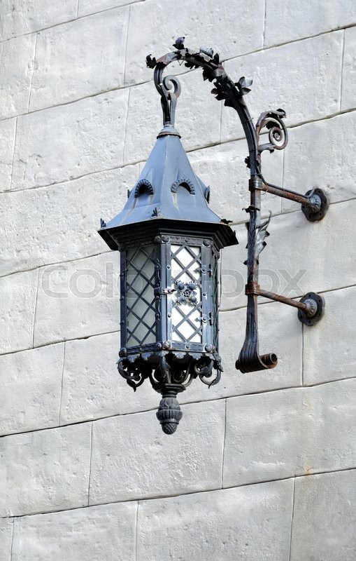 Stock image of 'Vintage street lantern on the  wall.'