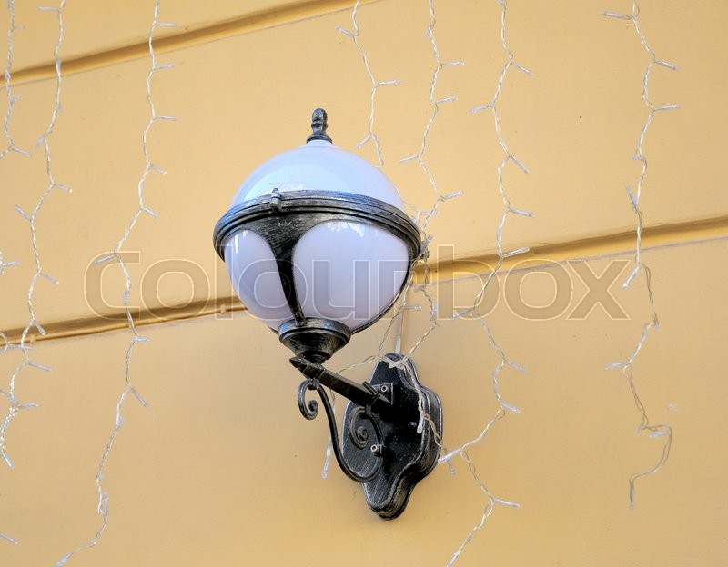 Stock image of 'Old lamp lantern on the stone wall , process in vintage style picture '