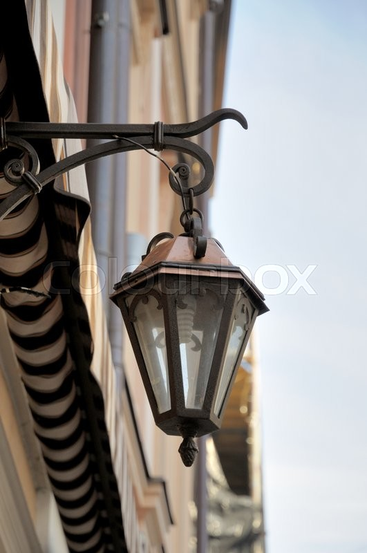 Stock image of 'Ancient street lighting lamp hanging on the wall'