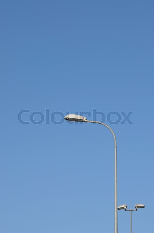 Stock image of 'Lamp street lighting on the background of blue sky.'