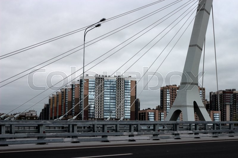 Stock image of 'urban landscape with suspension bridge'